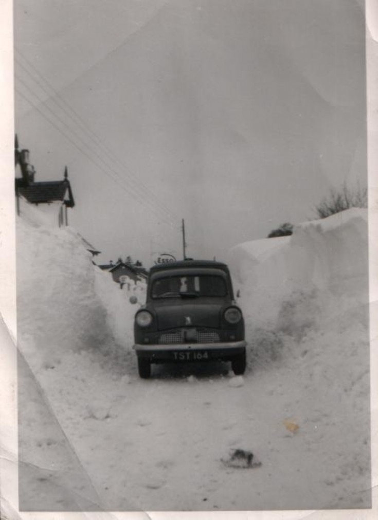 Car by Esso sign c1940s?