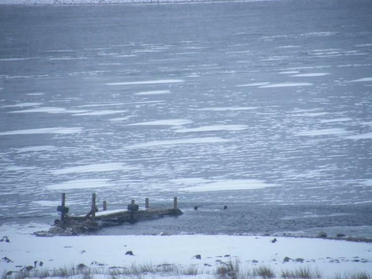 Loch Ericht frozen at Ben Alder pier